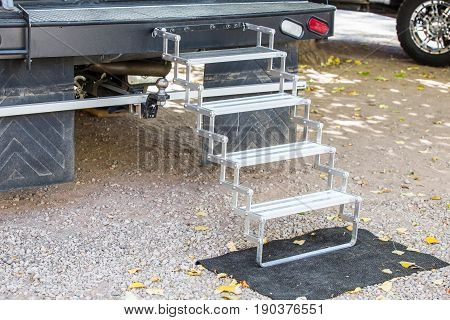 step on rv camping van in campground