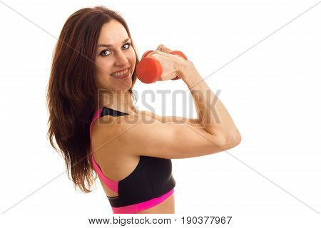 close-up portrait of a young strong sports Brunettes with Dumbells above in hand isolated on white background