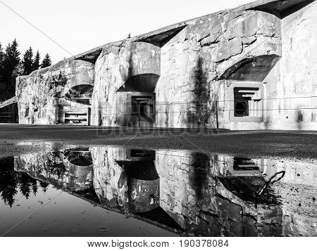 Artillery fortress Hanicka in Orlicke Hory, Czech Republic. Old massive stronghold from World War II. Black and white image.