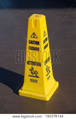 Slippery Floor Surface Warning Sign And Symbol In Building, Restroom. Concept Photo Danger.