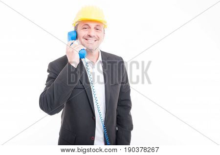 Architect Talking On Blue Big Telephone Receiver