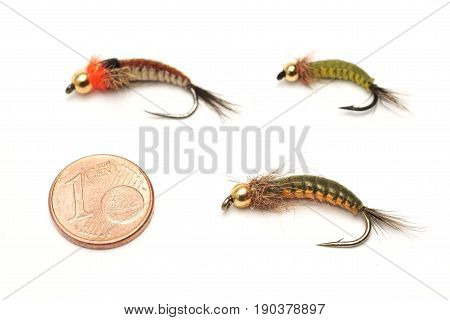Fly fishing bait and one euro cent for size comparison