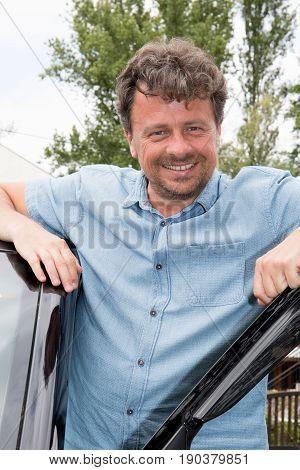 In Open Van Door Cheerful Man Outdoor