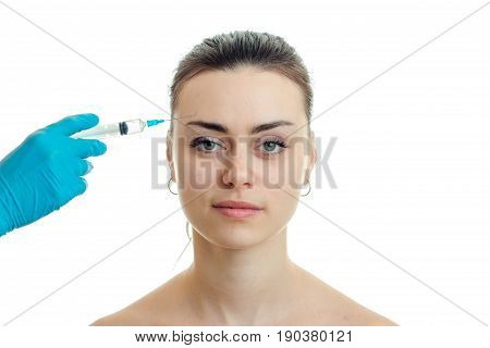 a close-up portrait smiling female doctor that does prick on her face isolated on white background