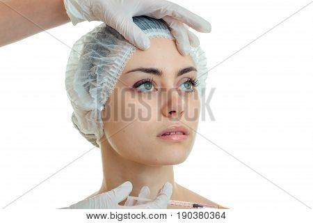 close-up portrait of a young girl without makeup medical Hat isolated on white background