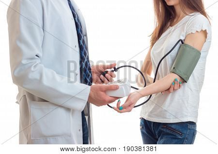 close-up of woman at doctor takes pressure isolated on white background