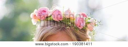 Close-up of wreath on woman's head outdoor