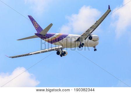 Bangkok, Thailand. - April 23, 2017 : Plane of Thai Airways in the sky landing to Suvanabhumi airport.