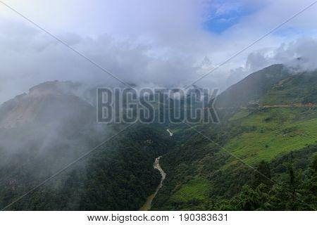 Scenery overlooking the foggy hills and Mangde Chhu (Tongsa River) in Bumthang Bhutan