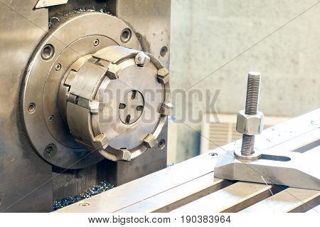 Horizontal side mill machine. Metalworking mechanical engineering lathe and milling technology. Indoors horizontal image.