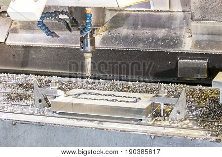 Industrial metal mold/blank speed drilling. Metalworking mechanical engineering lathe and milling technology. Indoors horizontal image.