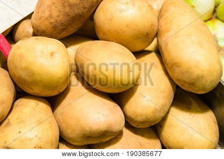 Fresh organic young potatoes sold on market