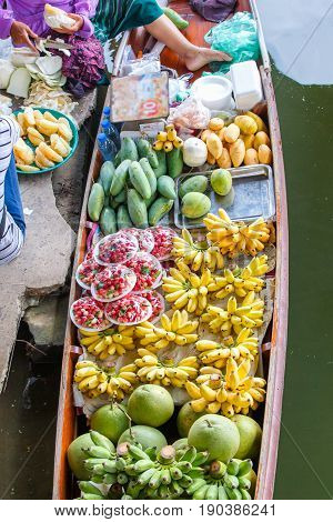 Long-tail boat with fruits on the floating market Damnoen Saduak floating market in Ratchaburi near Bangkok Thailand