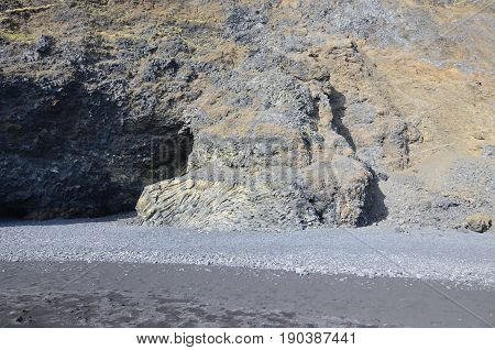 Cavern made of basalt columns on Vik's black sand beach.