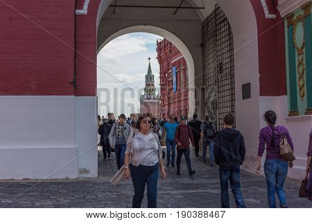 RUSSIA MOSCOW JUNE 8 2017: Entrance to Red Square from Iberian Gate and Chapel. People walking