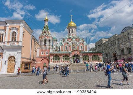 RUSSIA MOSCOW JUNE 8 2017: Undefined people walk near the Kazan Cathedral. Kazan Cathedral is a Russian Orthodox church located on the northeast corner of Red Square in Moscow Russia
