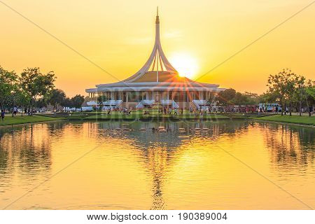 Bangkok, Thailand. - April 23, 2017 : Sunlight, Sunrays or sunbeam star over the roof of Ratchamangkhala Pavilion at public park name Suan Luang Rama IX on sunset time Bangkok, Thailand.
