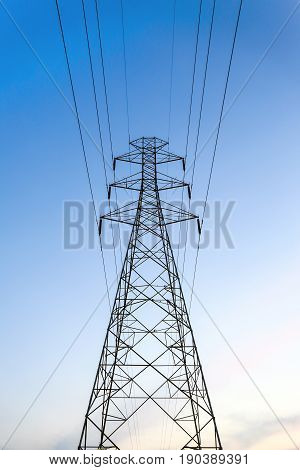 High voltage tower electric pole with blue sky.