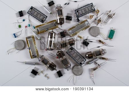 Various old, vintage radio components on white background