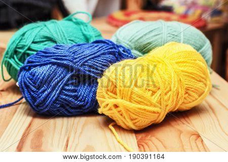 Nice multi-colored skeins of wool in room