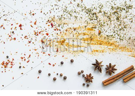 Close-up View Of Dried Aromatic Spices And Herbs Scattered On Grey