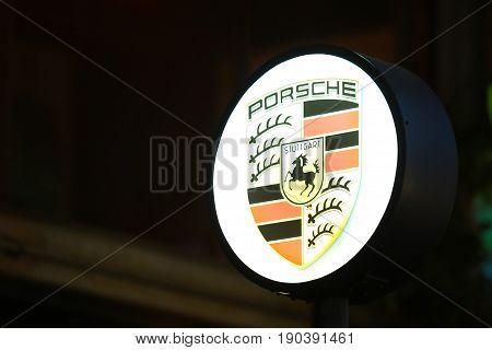Bangkok, Thailand - 23 January 2016 : Porsche Sign at night background.