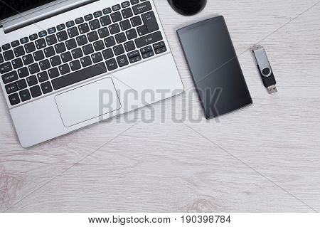 Aeriel View Of Laptop With Smartphone And Usb Stick