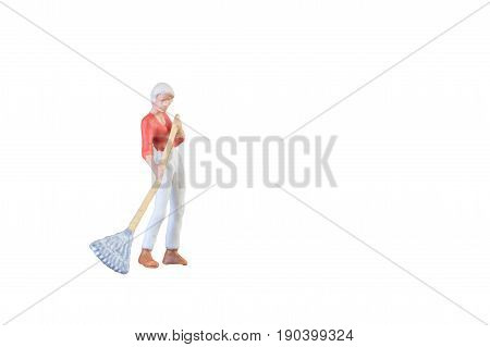 Close Up Of Miniature Farmer People Isolated With Clipping Path On White Background . Elegant Design