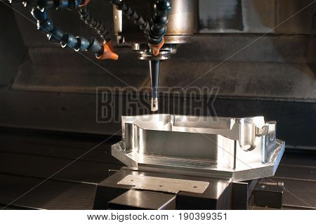 Industrial metal mold/ blank milling. Metalworking and mechanical engineering. CNC technology. Side view.
