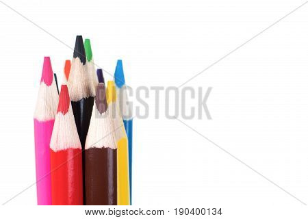 Colorful set of wooden pencil crayons with their points grouped in a bundle isolated on white with copy space in an art creativity or school and education concept