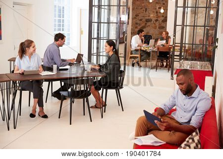 Young professionals working in an open plan office