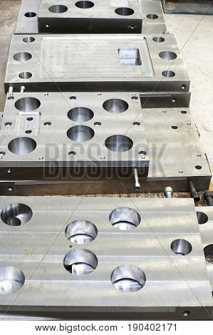 Punch press tooling. Steel detail of lathe and milling technology. Metal engineering industry.