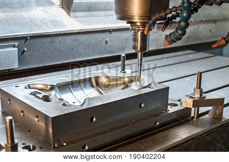 Industrial metal mold/blank milling. Metalworking. Lathe milling and drilling industry. CNC technology.