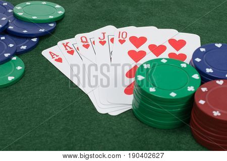 Close Up View Of Five Playing Cards Showing Flush