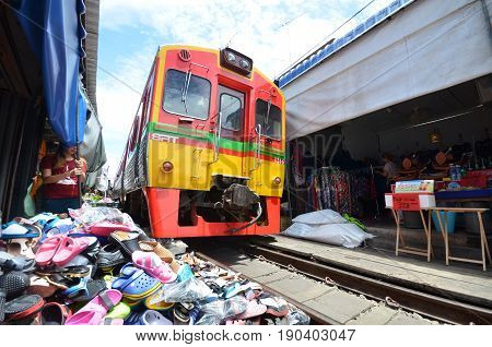 MAE KLONG THAILAND- MAY 17 2017: Mae Klong Market placed all product on railroad all vendors have to move product away when the train passes market.