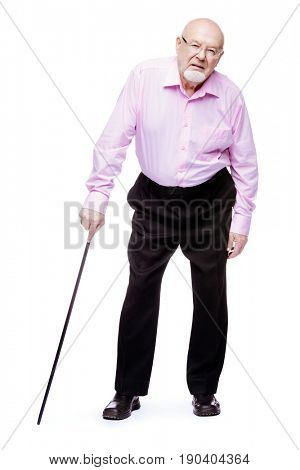 The old man standing with walking stick. Back hurts, radiculitis. Health care for the elderly people.