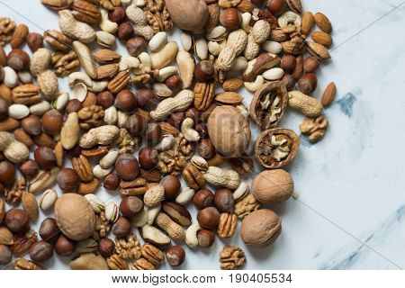 Assorted nuts on white surface