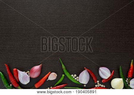 Asian cuisine ingredients food top view spice onion garlic chili pepper for cooking original eastern foods style on top wood texture background Thailand food spices
