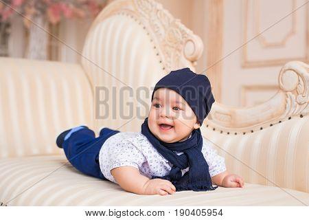 Adorable Caucasian baby boy. Adorable baby boy in white sunny bedroom. Newborn child