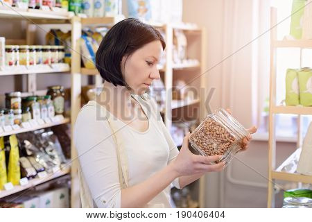 Woman Buying Pinto Beans