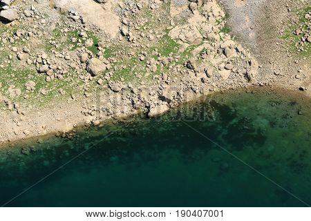 view on the sinkhole blue lake in Imotski, Croatia
