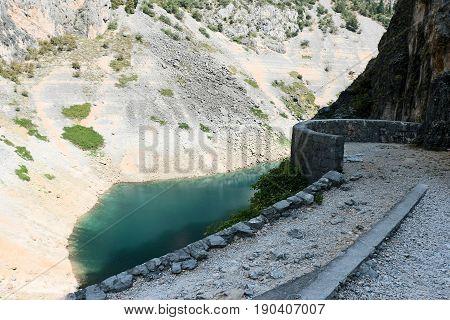 hiking trail to the blue lake of Imotski in Croatia
