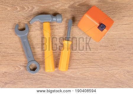 Small House Next To Plastic Toy Tools