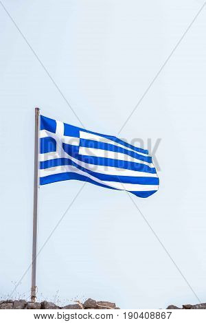 National Flag of Greece fluttering on the wind against sky.
