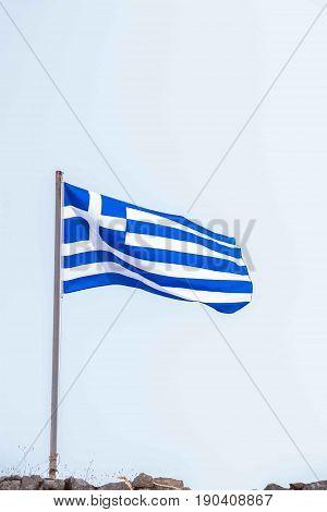 National Flag of Greece fluttering on the wind against sky.