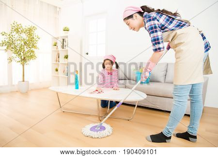 Mum Teaching Daughter Cleaning Home