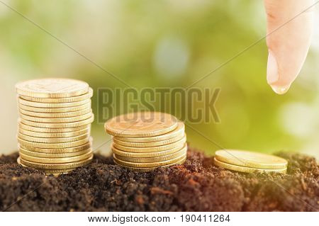 saving money preset by Male hand water plant money coin growing up concept in business finance and account bank