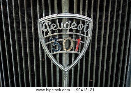 PAAREN IM GLIEN GERMANY - JUNE 03 2017: Emblem of a large family car Peugeot 301C 1933. Exhibition