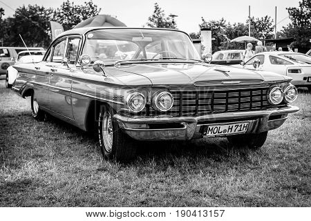 PAAREN IM GLIEN GERMANY - JUNE 03 2017: Full-size car Oldsmobile Dynamic 88 1960. Black and white. Exhibition