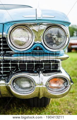 PAAREN IM GLIEN GERMANY - JUNE 03 2017: Headlamp of a full-size luxury car Cadillac Coupe DeVille 1959. Exhibition